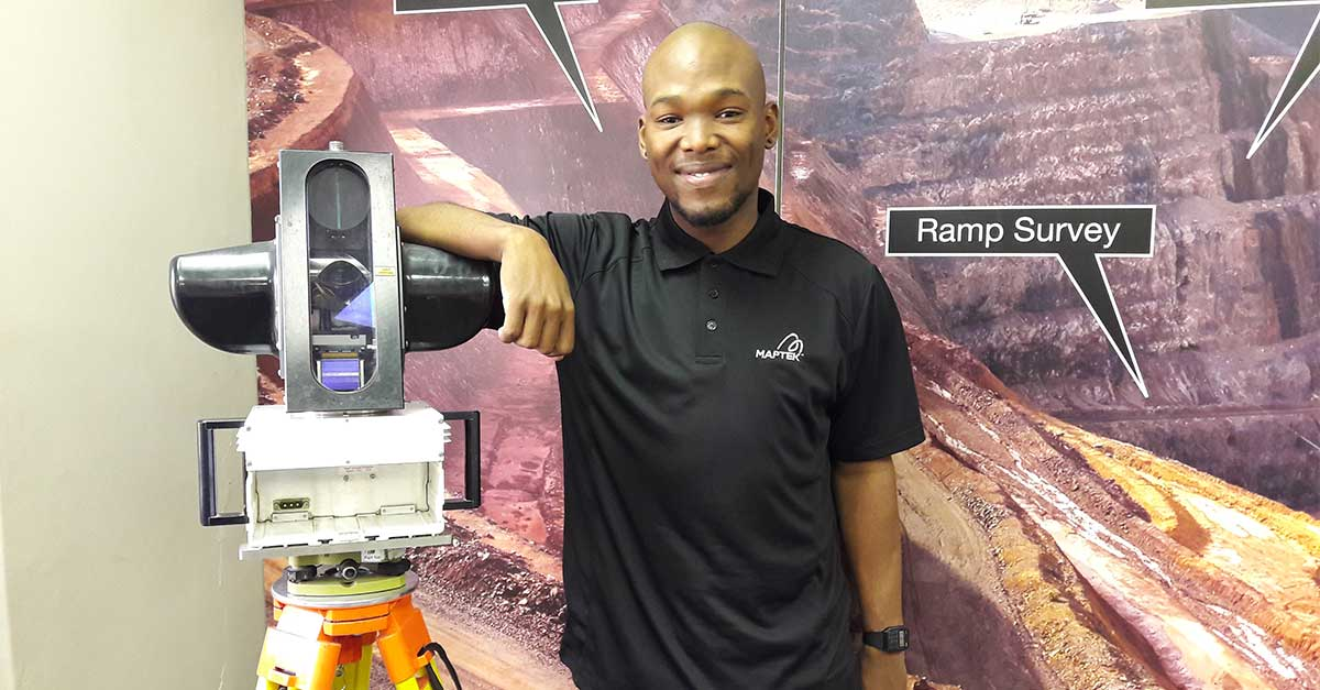 Dumisa Mhlobo with a display model I-Site 4400 laser scanner.