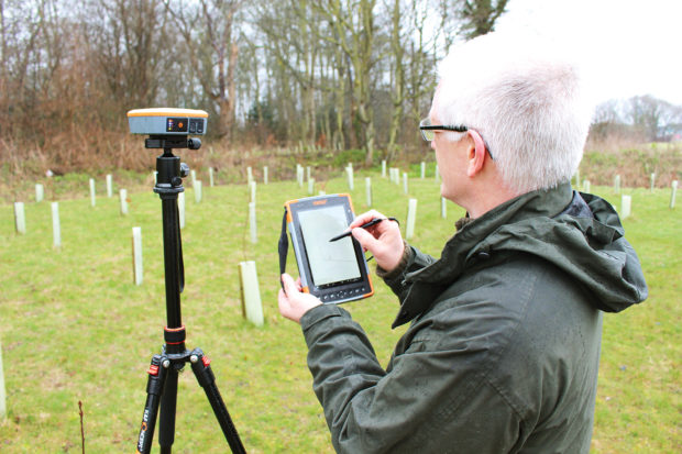 Fig. 3: Jonathan Smith of Pear Technology records a point on the tablet, as the handheld rugged computer receives data from the nearby receiver.