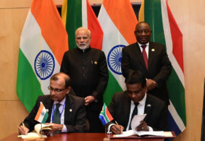 Narendra Modi, India's prime minister, and South Africa's president Cyril Ramaphosa, with TS Tirumurti from India's Ministry of External Affairs and Dr Valanathan Munsami, CEO of SANSA.