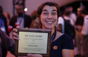 Astrid Emde after receiving the 2018 Sol Katz Award at FOSS4G-Dar es Salaam.
